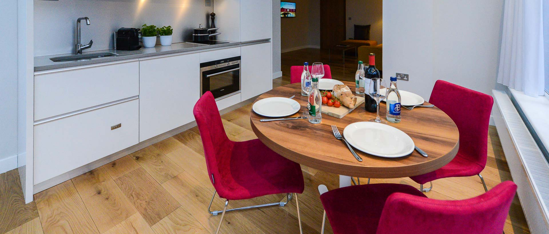 The dining table set up for lunch at PREMIER SUITES PLUS Dublin Ballsbridge serviced apartments