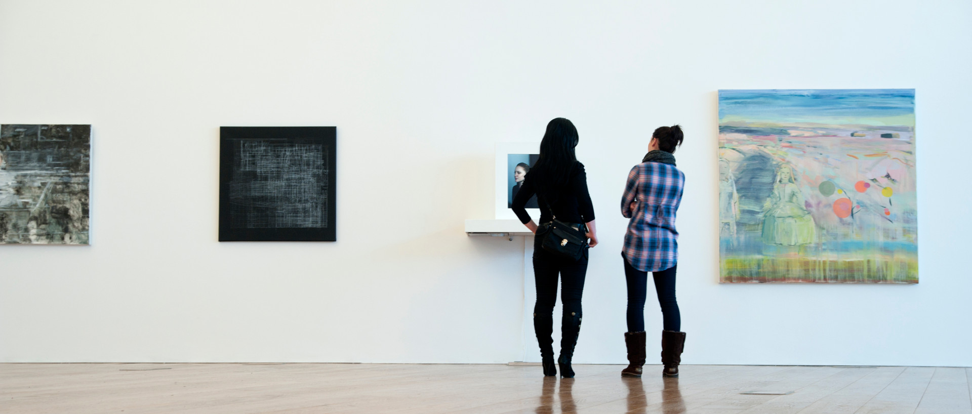 Ladies looking at a panting in an art gallery in Dublin